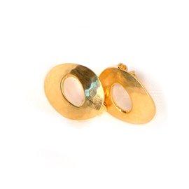 Boucles d'oreilles percées bijou de créateur anneaux dorés